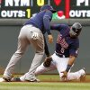 Photo - Minnesota Twins' Eduardo Escobar, right, slides into the tag by Tampa Bay Rays shortstop Yunel Escobar, left, and is out attempting to steal second base during the third inning of a baseball game, Sunday, Sept. 15, 2013, in Minneapolis. (AP Photo/Ann Heisenfelt)