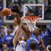 Oklahoma City\'s Serge Ibaka (9) blocks the shot of Dallas\' Dirk Nowitzki (41) during Game 4 of the first round in the NBA playoffs between the Oklahoma City Thunder and the Dallas Mavericks at American Airlines Center in Dallas, Saturday, May 5, 2012. Photo by Bryan Terry, The Oklahoman