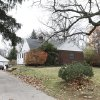 The house at 5142 Harvest Lane in Toledo, Ohio is seen Tuesday Nov. 13, 2012. Three children, their uncle, and their grandmother were found dead inside a garage at the house Monday in what appears to be a murder-suicide amid a custody dispute in Toledo, Ohio. (AP Photo/Rick Osentoski)