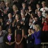 First lady Michelle Obama is applauded before President Barck Obama\'s State of the Union address during a joint session of Congress on Capitol Hill in Washington, Tuesday Feb. 12, 2013. Front row, from left are, Sgt. Sheena Adms, Nathaniel Pendleton, Cleopatra Cowley-Pendleton, Mrs, Obama, Menchu de Luna Sanchez and Jill Biden. Second row, third from left are, Oregon Gov. John Kitzhaber, Deb Carey and Apple CEO Tim Cook Amanda McMillian, Lt. Brian Murphy, (AP Photo/Pablo Martinez Monsivais) ORG XMIT: CAP113