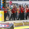 Funny Car driver Courtney Force\'s crew celebrates her championship run that gave her the 100th victory by a female driver in NHRA history at the NHRA Kansas Nationals drag races on Sunday, May 25, 2014, at Heartland Park in Topeka, Kan. (AP Photo/Topeka Capital-Journal, Chris Neal)
