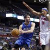 Photo - Orlando Magic guard J.J. Redick looks to pass against Detroit Pistons forward Charlie Villanueva (31) in the first half of an NBA basketball game Tuesday, Jan. 22, 2013, in Detroit. (AP Photo/Duane Burleson)