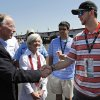 Photo - Former Alabama Quarterback AJ McCarron, right, shakes the hand of Alabama Gov. Robert J. Bentley as Alabama first lady Dianne Jones Bentley looks on before the NASCAR Aaron's 499 Sprint Cup series auto race at Talladega Superspeedway, Sunday, May 4, 2014, in Talladega, Ala. (AP Photo/Butch Dill)