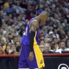 Los Angeles Lakers guard Kobe Bryant walks back down court after they turned over the ball during the second half of their NBA basketball game against the Los Angeles Clippers, Friday, Jan. 4, 2013, in Los Angeles. The Clippers won 107-102. (AP Photo/Mark J. Terrill)