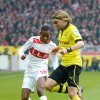 Stuttgart\'s Ibrahima Traor, left, challenges for the ball with Dortmund\' s Marcel Schmelzer, right, during the German first division, Bundesliga, soccer match between VfB Stuttgart and Borussia Dortmund in Stuttgart, southern Germany, Saturday March 30, 2013. (AP Photo/dpa,Marijan Murat)