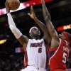 Miami Heat\'s LeBron James (6) prepares to shoot over Atlanta Hawks\' Josh Smith (5) during the first half of an NBA basketball game, Monday, Dec, 10, 2012, in Miami. The Heat won 101-92. (AP Photo/Alan Diaz)