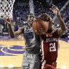 Photo - Kansas State's Wesley Iwundu (25) and Oklahoma's Cameron Clark (21) viefor a rebound during the first half of an NCAA college basketball game Tuesday, Jan. 14, 2014, in Manhattan, Kan. (AP Photo/Charlie Riedel)