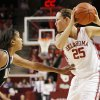 OU\'s Whitney Hand keeps the ball away from Missouri\'s Alyssa Hollins during a 2009 game in Norman. PHOTO BY NATE BILLINGS, The Oklahoman Archives