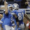 Photo - Detroit Lions quarterback Matthew Stafford (9) congratulates teammate Calvin Johnson after Johnson scored on a 46-yard reception during the third quarter of an NFL football game against the Indianapolis Colts at Ford Field in Detroit, Sunday, Dec. 2, 2012. (AP Photo/Paul Sancya)
