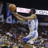 Photo - Golden State Warriors' Ian Clark goes up for a shot against the Phoenix Suns in the second quarter of the NBA Summer League championship game, Monday, July 22, 2013, in Las Vegas. (AP Photo/Julie Jacobson)