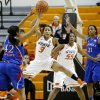 Kansas\' Natalie Knight (42) passes the ball around Oklahoma State\'s Tiffany Bias (3) during a women\'s college basketball game between Oklahoma State University (OSU) and Kansas at Gallagher-Iba Arena in Stillwater, Okla., Tuesday, Jan. 8, 2013. Photo by Bryan Terry, The Oklahoman
