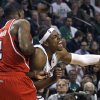 Boston Celtics forward Paul Pierce (34) yells as he slams into Atlanta Hawks defender Joe Johnson (2) during the second quarter of Game 3 of an NBA first-round playoff basketball series, Friday, May 4, 2012, in Boston. (AP Photo/Charles Krupa)
