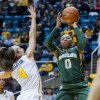 Photo - Baylor's Odyssey Sims shoots as West Virginia's Brooke Hampton (4) defends during the first half of an NCAA college basketball game Wednesday, Jan. 8, 2014, in Morgantown, W.Va. (AP Photo/Andrew Ferguson)