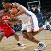 Oklahoma City\'s Thabo Sefolosha runs into pressure from Philadelphia\'s defense during the first half of their NBA basketball game at the Ford Center in Oklahoma City on Tuesday, Dec. 2, 2009. By John Clanton, The Oklahoman