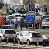 New Jersey state troopers keep order as motorist line up to purchase gasoline at the Thomas A. Edison service area on the New Jersey Turnpike Saturday, Nov. 3, 2012, near Woodbridge, N.J. From storm-scarred New Jersey to parts of Connecticut, a widespread lack of gasoline added to the frustration since Superstorm Sandy passed through the area. Gas rationing was to starting at noon Saturday in northern New Jersey, where drivers will be allowed to buy it only every other day. (AP Photo/Mel Evans)