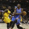 Oklahoma City Thunder\'s Kevin Durant, right, drives to the basket against Cleveland Cavaliers\' Dion Waiters during the first quarter of an NBA basketball game on Saturday, Feb. 2, 2013, in Cleveland. (AP Photo/Tony Dejak) ORG XMIT: OHTD101