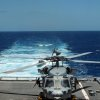 """Photo - A Navy helicopter prepares to take off from the USS Independence during an exercise in waters off Honolulu on Thursday, July 24, 2014. Navy Secretary Ray Mabus says operating costs for the service's newest ships,  littoral combat ships like the Independence, will decline and """"become more normal"""" over time. (AP Photo)"""