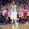 Oklahoma City\'s Thabo Sefolosha (2) reacts after hitting a three point shot late in the game during Game 2 in the first round of the NBA playoffs between the Oklahoma City Thunder and the Houston Rockets at Chesapeake Energy Arena in Oklahoma City, Wednesday, April 24, 2013. Photo by Chris Landsberger, The Oklahoman