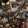 People march on the streets, displaying banners and Palestinian flags, as they shout anti Israeli slogans, during a protest against the Israeli air strikes of the Gaza strip, in Madrid, Spain, Thursday, July 17, 2014. About 2,000 people took part in the demonstration. (AP Photo/Daniel Ochoa de Olza)