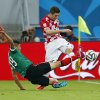 Mexico\'s Oribe Peralta, left, fights for the ball with Croatia\'s Sime Vrsaljko during the group A World Cup soccer match between Croatia and Mexico at the Arena Pernambuco in Recife, Brazil, Monday, June 23, 2014. (AP Photo/Eduardo Verdugo)