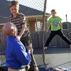 Eric Littleton, left, holds son Solomon Littleton, 7, as Solomon\'s twin brother Isaac Littleton jumps on a trampoline at their home, 17313 Zinc Drive, in Edmond, Okla., Thursday, December 16, 2010. Solomon Littleton has a neurological disorder that gives him symptoms similar to autism and Alzheimer\'s disease. Photo by Nate Billings, The Oklahoman