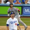 Photo - Boston Red Sox's Jarrod Saltalamacchia, left, hits a two-run home run as Los Angeles Dodgers relief pitcher Chris Withrow looks on during the sixth inning of their baseball game, Sunday, Aug. 25, 2013, in Los Angeles.  (AP Photo/Mark J. Terrill)