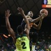 Photo - Oklahoma State guard Markel Brown (22) scores past Baylor forward Rico Gathers (2) in the first half of an NCAA college basketball game, Monday, Feb. 17, 2014, in Waco, Texas. (AP Photo/Waco Tribune Herald, Rod Aydelotte)