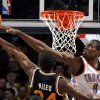 Oklahoma City\'s Serge Ibaka (9) blocks Utah\'s Paul Millsap (24) shot during the NBA basketball game between the Oklahoma City Thunder and Utah Jazz, Wednesday, March 23, 2011, at the Oklahoma City Arena. Photo by Sarah Phipps, The Oklahoman