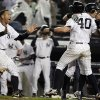 New York Yankees\' Alex Rodriguez, left, celebrates with Francisco Cervelli (40) and Ichiro Suzuki, right, of Japan, after Cervelli scored on an RBI single from Raul Ibanez in the 12th inning of a baseball game against the Boston Red Sox, Tuesday, Oct. 2, 2012 in New York. The Yankees won 4-3. (AP Photo/Frank Franklin II)