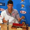 Photo - Novak Djokovic of Serbia sits next to boxes of chocolate before handing out reporters during a press conference, ahead of the Australian Open tennis championship in Melbourne, Australia, Sunday, Jan. 12, 2014. (AP Photo/Shuji Kajiyama)