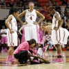 From left, Oklahoma\'s Gioya Carter (25), Nicole Griffin (4), Morgan Hook (10) and Sharane Campbell (24) watch athletic trainer Carolynn Loon attend to Aaryn Ellenberg (3) after she was injured in the second half during the women\'s Bedlam college basketball game between the OU Sooners and the OSU Cowgirls at Gallagher-Iba Arena in Stillwater, Okla., Sunday, Feb. 16, 2014. OSU won, 73-57. Photo by Nate Billings, The Oklahoman