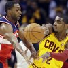 Photo -   Cleveland Cavaliers' Kyrie Irving (2) passes away from Washington Wizards' A.J. Price in the first quarter of an NBA basketball game, Tuesday, Oct. 30, 2012, in Cleveland. (AP Photo/Mark Duncan)