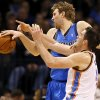 Oklahoma City\'s Nick Collison (4) defends Dallas\' Dirk Nowitzki (41) during an NBA basketball game between the Oklahoma City Thunder and the Dallas Mavericks at Chesapeake Energy Arena in Oklahoma City, Sunday, March 16, 2014. Photo by Nate Billings, The Oklahoman