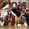 Sooner\'s Buddy Hield, left, and Cowboy\'s Michael Cobbins fight for a ball under the basket as the University of Oklahoma Sooners (OU) play the Oklahoma State Cowboys (OSU) in NCAA, men\'s college basketball at The Lloyd Noble Center on Saturday, Jan. 12, 2013 in Norman, Okla. Photo by Steve Sisney, The Oklahoman
