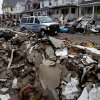 Photo -   An New York Police Department van drives along a street soaked with rain and covered with debris in a Rockaway neighborhood of the borough of Queens, New York, Wednesday, Nov. 7, 2012, as a nor'easter aggravates already bad conditions in the wake of Superstorm Sandy. (AP Photo/Craig Ruttle)