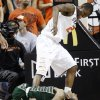 South Florida\'s Anthony Collins, bottom, grimaces after a foul by Oklahoma State forward Kamari Murphy, top, in the first half of an NCAA college basketball game in Stillwater, Okla., Wednesday, Dec. 5, 2012. (AP Photo/Sue Ogrocki)
