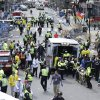 Photo - Medical workers aid injured people at the finish line of the 2013 Boston Marathon following an explosion in Boston, Monday, April 15, 2013. (AP Photo/Charles Krupa)
