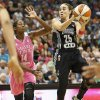 San Antonio Stars guard Becky Hammon (25) looks to pass the ball against Minnesota Lynx forward Devereaux Peters (14) in the second half of a WNBA basketball game, Friday, July 25, 2014, in Minneapolis. The Lynx won 88-78. (AP Photo/Stacy Bengs)