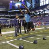 Photo - Oklahoma defensive lineman Ronnell Lewis runs a drill at the NFL football scouting combine in Indianapolis on Monday, Feb. 27, 2012. (AP Photo/Dave Martin) ORG XMIT: NAS210