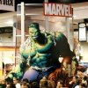 """Photo -   In this July 24, 2008 file photo, Marvel Comics """"Incredible Hulk"""" looms over attendees at the Comic-Con 2008 convention in San Diego. The Walt Disney Co. said Monday, Aug. 31, 2009, it is buying Marvel Entertainment Inc. for $4 billion in cash and stock, bringing characters like Iron Man and Spider-Man into the family of Mickey Mouse and WALL-E.(AP Photo/Denis Poroy, file)"""