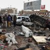 Pakistani police officers and local residents gather at the site of a bomb blast that targeted paramilitary soldiers in a commercial area in Quetta, Pakistan, killing at least 12 people and wounding more than 40 others, according to police, Thursday, Jan. 10, 2013. A series of bombings in different parts of Pakistan killed 115 people on Thursday in one of the deadliest days in the country in recent years. (AP Photo/Arshad Butt)