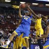 UCLA\'s Alyssia Brewer (32) grabs a rebound in front of California\'s Gennifer Brandon in the first half of an NCAA college basketball game in the Pac-12 Conference tournament Saturday, March 9, 2013, in Seattle. (AP Photo/Elaine Thompson)