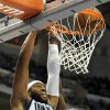 Dallas Mavericks guard Vince Carter (25) dunks in front of Charlotte Bobcats forward Bismack Biyombo during the second half of an NBA basketball game, Saturday, Nov. 3, 2012 in Dallas. The Mavericks won 126-99. (AP Photo/Matt Strasen)