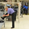 Photo - A traveler removes his shoes at Hartsfield-Jackson Atlanta International Airport on Wednesday, Jan. 15, 2014 in Atlanta.  The Transportation Security Administration (TSA) officially opened a