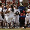 Oklahoma celebrates during a Women\'s College World Series game between Oklahoma University and Arizona State University at ASA Hall of Fame Stadium in Oklahoma City, Sunday, June 3, 2012. Photo by Garett Fisbeck, The Oklahoman