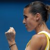 Photo - Flavia Pennetta of Italy celebrates a point won against  Agelique Kerber of Germany during their fourth round match at the Australian Open tennis championship in Melbourne, Australia, Sunday, Jan. 19, 2014.(AP Photo/Aaron Favila)