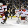 Photo - Carolina Hurricanes defenseman John-Michael Liles (26) battles with Buffalo Sabres left winger Matt Moulson (26) as goaltender Anton Khudobin (31), of Russia, eyes the incoming puck during the first period of an NHL hockey game in Buffalo, N.Y., Thursday, Jan. 23, 2014. (AP Photo/Gary Wiepert)