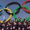 In this still image taken from video, members of the men\'s ice hockey team from the United States post in front of the Olympic rings in Olympic Park during the 2014 Winter Olympics in Sochi, Russia, on Thursday, Feb. 20, 2014. The U.S. and Canada will play each other in the semifinal round on Friday, Feb. 21. (AP Photo/Ben Jary)
