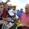 Arnold Palmer, right, signs autographs for fans after finishing the first round of the Father/Son Challenge golf tournament in Orlando, Fla., Saturday, Dec. 15, 2012.(AP Photo/Phelan M. Ebenhack)