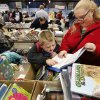 Shannon and her son Avery, 6, from Edmond, sort through boxes filled with books about animals. Several thousand bibliophiles and bargain hunters crowded into Oklahoma Expo Hall at State Fair Park on Saturday, Feb. 23, 2013, in a quest to find reading material at deeply discounted prices. Friends of the Metropolitan Library System is holding their much-anticipated annual book sale this weekend. The sale continues Sunday from 9 a.m. to 5:30 p.m. Photo by Jim Beckel, The Oklahoman